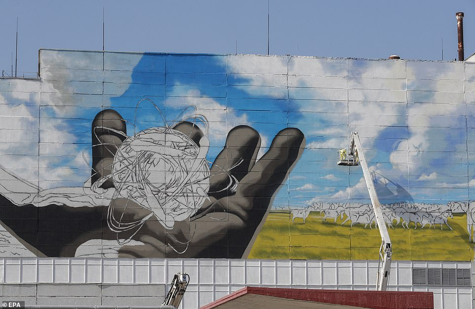 19102050-7520185-Workers_paint_a_giant_mural_on_the_Chernobyl_nuclear_power_plant-a-76_1569842114380