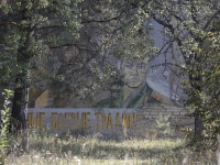 19102048-7520185-Soviet_era_graffiti_on_a_wall_of_the_military_base_which_operate-a-77_1569842114705