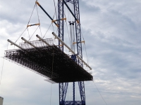 rebar-cages-are-lifted-off-the-deck-for-placement-in-the-excavation_8112876935_o