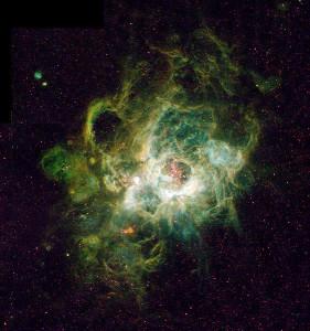 Některé mlhoviny jsou zárodečnou oblastí hvězd, není proto divu, že jsou také tvořeny plazmatem. Na snímku emisní mlhovina NGC 604.
