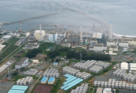 an-aerial-view-shows-the-tokyo-electric-power-co-s-tepco-tsunami-crippled-fukushima-daiichi-nuclear-power-plant-and-its-contaminated-water-storage-tanks-top-in-fukushima-in-aug-31-photo