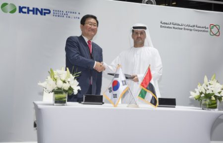 KHNP CEO Mr  Seok Cho and ENEC CEO H E  Mohamed Al Hammadi sign OSSA 460